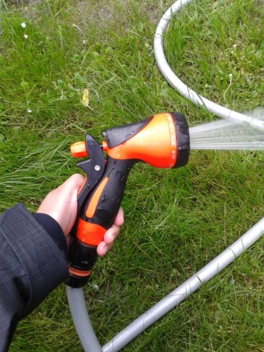 Montessori practical life - a spray pistol on a garden hose